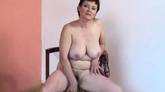 Kinky housewife with big tits Jarelle sits on a chair and masturbates