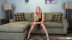 Stunning blonde Nikki Seven sits on the sofa sharing her fantasies and desires