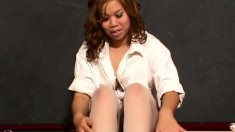 Sumalee gets dirty and lets you glimpse her ass and cunt through her pantyhose