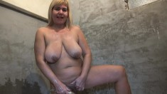 Big tit chubby blonde granny sucks her titties and fingers her snatch