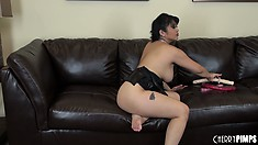 Mika Tan guides a huge dildo into her cunt using her dainty feet