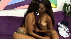 Two stunning caramel lesbians share a red dildo and reach their climax