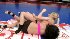 Female wrestlers get it on and go to the mat for some pussy tasting