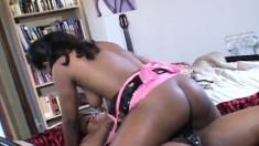 Bodacious ebony lesbians explore their desires with a strap-on dildo