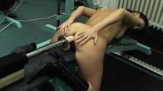 Athletic brunette with perfect hooters gives a mechanical dildo a try