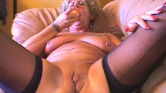 Tattooed milf with big hooters bounces on a stiff pole with excitement