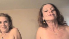 Hung guy has two street hookers working their mouths on his hard pole