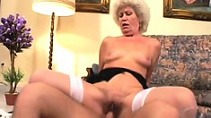 Blonde granny in stockings gets wrecked by a big young schlong