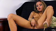 Watch as this blonde babe teases herself with a golden toy
