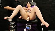 A fucking machine and a magic wand give her a massive orgasm