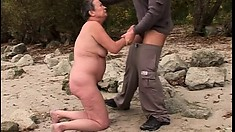 Fat grandma gets her needy holes pounded by the side of a lake