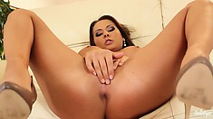 Watch this hot brunette in action as she bares her beautiful tits and ass