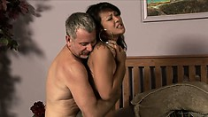 The hot babe has him pounding her all over the bed and sighs with satisfaction