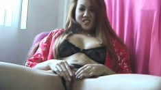 A beautiful Asian girl rubs her clit and sucks a big fat cock