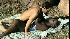 Ebony babe takes him to the base of the mountain to ride his white cock