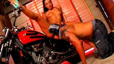 Gorgeous raven-head cutie is licked and stretched by biker's cock