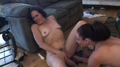 Five horny babes get together in the living room for a lesbian orgy