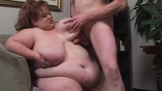 Fat redhead with massive tits gets topped by a hung skinny dude