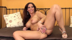Big boobed Syren De Mer shows off her body and toy fucks her cunt