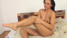 Sensuous brunette beauty reveals her amazing body and pleases her twat