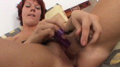 Redheaded slut toys her clit while he fingers her hole and then opens it