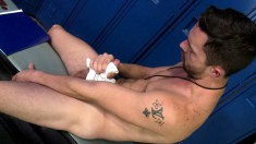 Hot hunk sits in the locker room to stroke his thick shaft until he cums