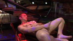 Muscled hunk Scot Bosco lies back on a chair to pump his hard cock