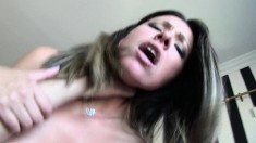 Big breasted brunette enjoys a long stick and takes a mouthful of cum