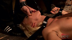 Blonde in device bondage is completely at her master's mercy