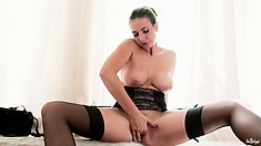 Her black garter belt makes her body look both slutty and classy