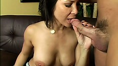 Asian beauty with perfect big boobs bounces on a stiff cock with great passion