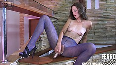 Lovely long-legged brunette pleasures herself with her favorite sex toy