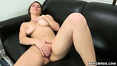 Teen chick is showing what she's got as she toys her pussy on the sofa